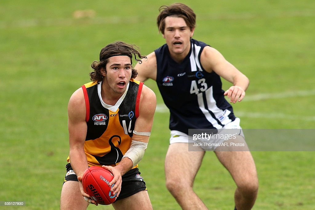 Aaron Darling of the Dandenong Stingrays runs with the ball during the round eight TAC Cup match between Dandenong Stingrays and Geelong Falcons at Shepley Oval on May 29, 2016 in Melbourne, Australia.