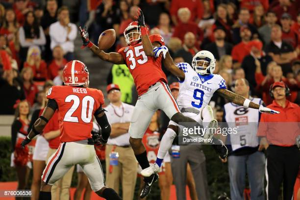 Aaron Davis of the Georgia Bulldogs intercepts a pass intended for Garrett Johnson of the Kentucky Wildcats during the second half at Sanford Stadium...