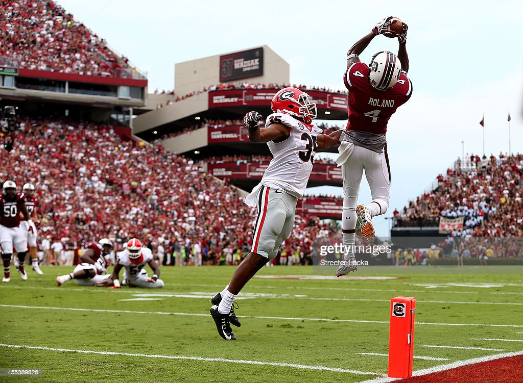 Aaron Davis of the Georgia Bulldogs watches as Shaq Roland of the South Carolina Gamecocks catches a touchdown during their game at WilliamsBrice...