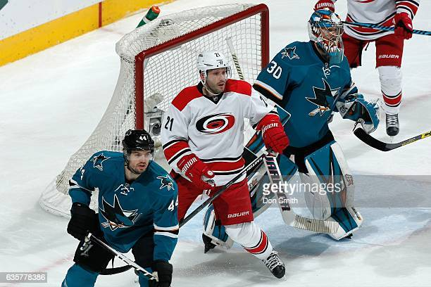 Aaron Dell and MarcEdouard Vlasic of the San Jose Sharks defend against Lee Stempniak of the Carolina Hurricanes during a NHL game at SAP Center at...