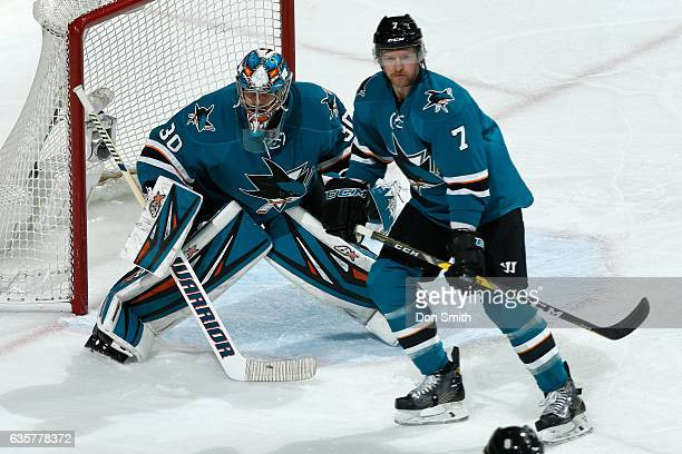 Aaron Dell and Paul Martin of the San Jose Sharks defend during a NHL game at SAP Center at San Jose on December 10 2016 in San Jose California