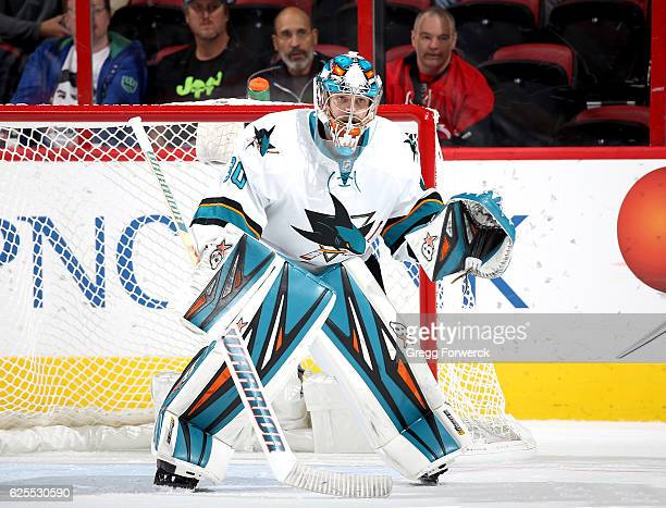 Aaron Dell of the San Jose Sharks crouches in the crease during an NHL game against the Carolina Hurricanes on November 15 2016 at PNC Arena in...