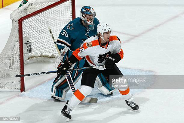 Aaron Dell of the San Jose Sharks defends against Dale Weise of the Philadelphia Flyers during a NHL game at SAP Center at San Jose on December 30...