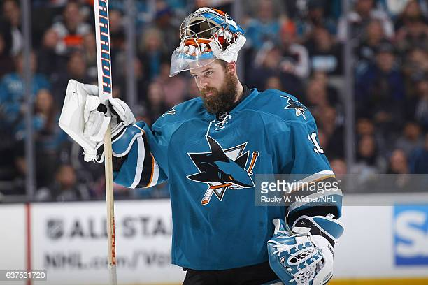 Aaron Dell of the San Jose Sharks defends looks on during the game against the Philadelphia Flyers at SAP Center on December 30 2016 in San Jose...