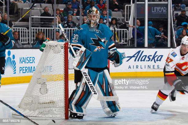 Aaron Dell of the San Jose Sharks defends the net against the Calgary Flames at SAP Center on April 8 2017 in San Jose California