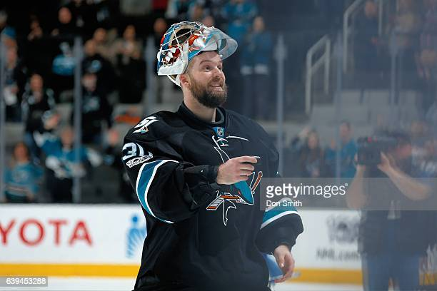 Aaron Dell of the San Jose Sharks gets ready to give a puck to a fan as one of the Three stars of the game after a NHL game against the Tampa Bay...