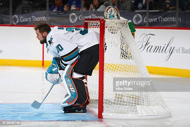 Aaron Dell of the San Jose Sharks looks on prior to the start of the game against the New York Islanders at the Barclays Center on October 18 2016 in...