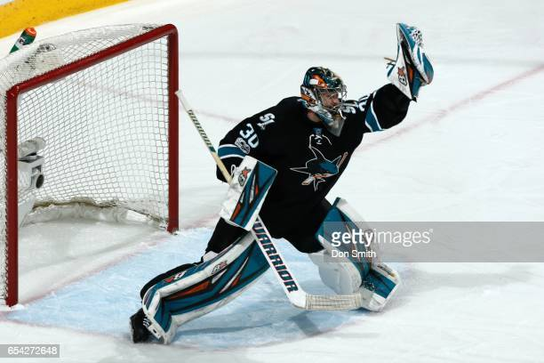 Aaron Dell of the San Jose Sharks makes a glove save during a NHL game against the St Louis Blues at SAP Center at San Jose on March 16 2017 in San...
