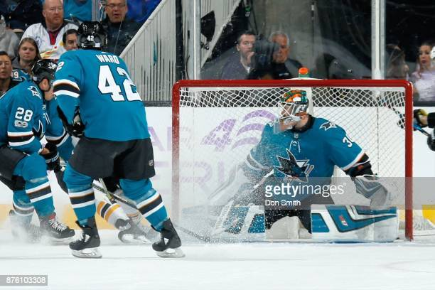 Aaron Dell of the San Jose Sharks protects the net during a NHL game against the Boston Bruins at SAP Center on November 18 2017 in San Jose...