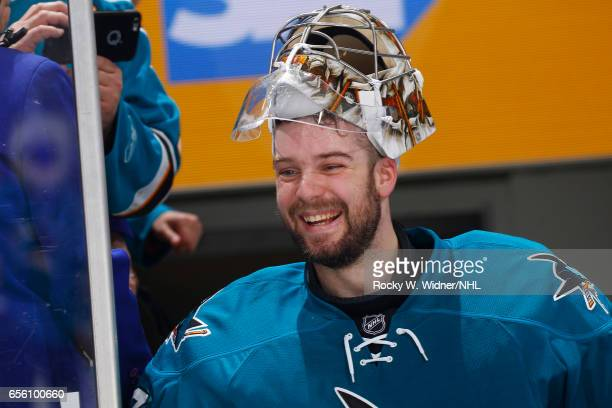 Aaron Dell of the San Jose Sharks smiles after defeating the Dallas Stars at SAP Center on March 12 2017 in San Jose California