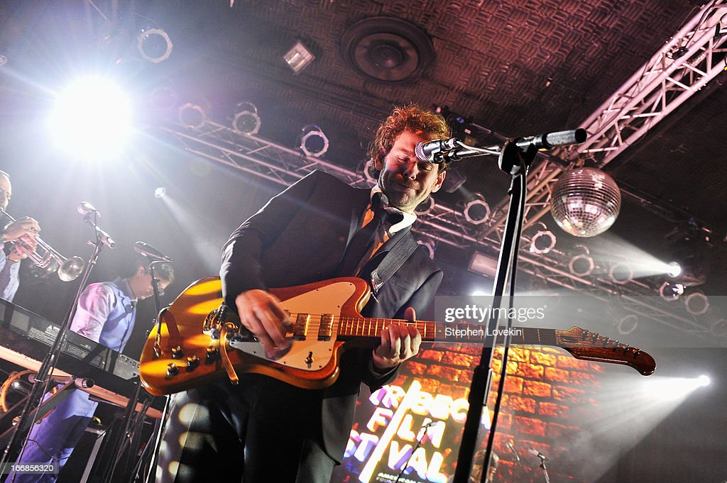 <a gi-track='captionPersonalityLinkClicked' href=/galleries/search?phrase=Aaron+Dessner&family=editorial&specificpeople=4502820 ng-click='$event.stopPropagation()'>Aaron Dessner</a> of The National performs at the Opening Night After Party and Performance during the 2013 Tribeca Film Festival on April 17, 2013 in New York City.