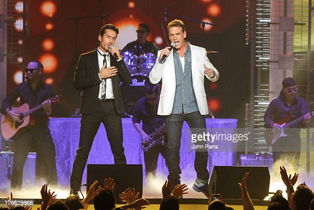 Aaron Diaz and Carlos Ponce on stage during Telemundo's Premios Tu Mundo Awards at American Airlines Arena on August 15 2013 in Miami Florida