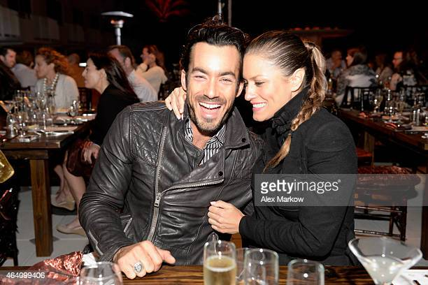 Aaron Diaz and Lola Ponce attend Belvedere Vodka Moet Chandon Champagne present Dinner hosted by Masaharu Morimoto and Anita Lo during the 2015 Food...