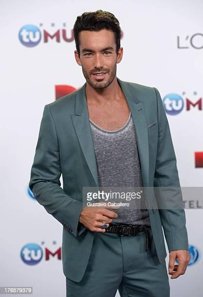 Aaron Diaz arrives for Telemundo's Premios Tu Mundo Awards at American Airlines Arena on August 15 2013 in Miami Florida