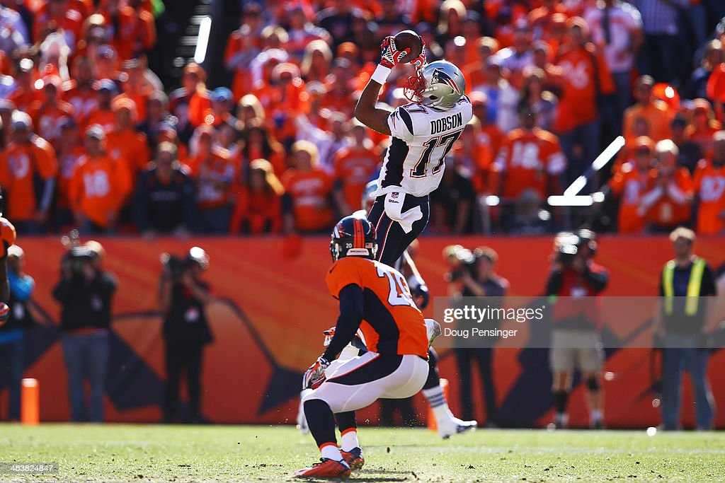 <a gi-track='captionPersonalityLinkClicked' href=/galleries/search?phrase=Aaron+Dobson&family=editorial&specificpeople=6336020 ng-click='$event.stopPropagation()'>Aaron Dobson</a> #17 of the New England Patriots completes a 27 yard reception for a first down in the seocnd quarter against the Denver Broncos during the AFC Championship game at Sports Authority Field at Mile High on January 19, 2014 in Denver, Colorado.