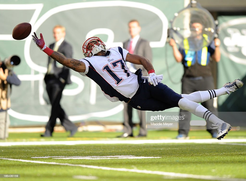<a gi-track='captionPersonalityLinkClicked' href=/galleries/search?phrase=Aaron+Dobson&family=editorial&specificpeople=6336020 ng-click='$event.stopPropagation()'>Aaron Dobson</a> #17 of the New England Patriots dives for the ball during the second half against the New York Jets at MetLife Stadium on October 20, 2013 in East Rutherford, New Jersey. The Jets defeat the Patriots 30-27 in overtime.
