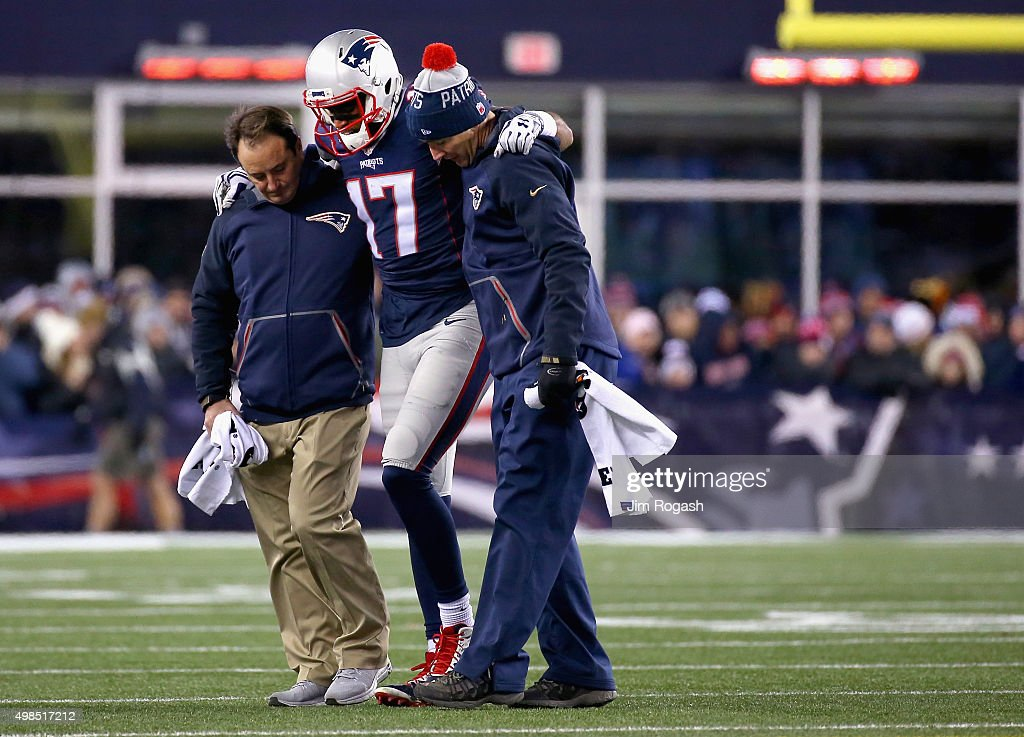 <a gi-track='captionPersonalityLinkClicked' href=/galleries/search?phrase=Aaron+Dobson&family=editorial&specificpeople=6336020 ng-click='$event.stopPropagation()'>Aaron Dobson</a> #17 of the New England Patriots is injured during the second quarter against the Buffalo Bills at Gillette Stadium on November 23, 2015 in Foxboro, Massachusetts.