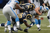 Aaron Donald and Nick Fairley both of the St Louis Rams sack Matthew Stafford of the Detroit Lions at the Edward Jones Dome on December 13 2015 in St...