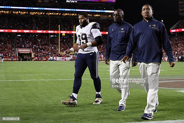 Aaron Donald of the Los Angeles Rams walks off the field after being ejected for contact with an official during the NFL game against the San...