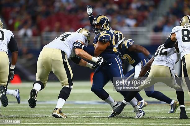 Aaron Donald of the St Louis Rams rushes the quarterback during the first half of a preseason game against the New Orleans Saints at the Edward Jones...