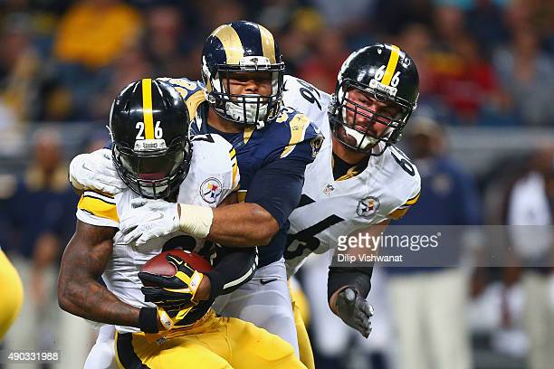 Aaron Donald of the St Louis Rams tackles Le'Veon Bell of the Pittsburgh Steelers as David DeCastro of the Pittsburgh Steelers looks on in the third...