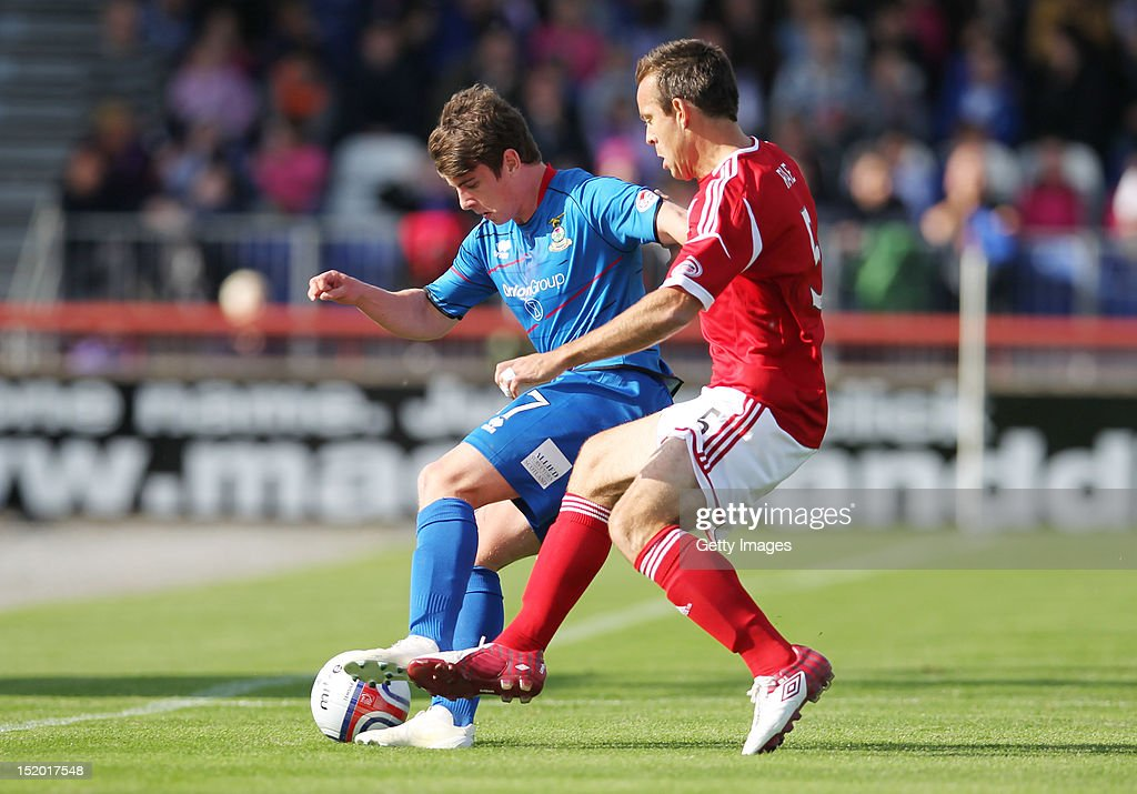 Aaron Doran of Inverness Caledonian Thistle competes with Gavin Rae of Aberdeen during the Clydesdale Bank Scottish Premier League match on September 15, 2012 in Inverness, Scotland.