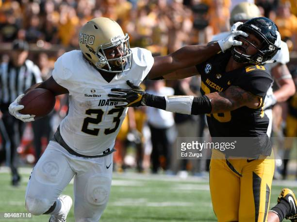 Aaron Duckworth of the Idaho Vandals stiff arms Kaleb Prewett of the Missouri Tigers as he tries to gains extra yards in the second quarter at...