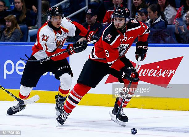 Aaron Dutra of the Quebec Remparts skates with the puck against the Baie Comeau Drakkar during their QMJHL hockey game at the Centre Videotron on...