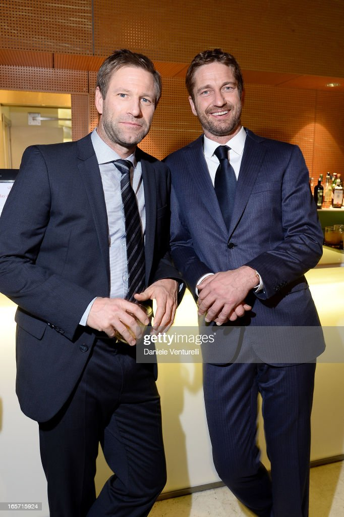 <a gi-track='captionPersonalityLinkClicked' href=/galleries/search?phrase=Aaron+Eckhart&family=editorial&specificpeople=220602 ng-click='$event.stopPropagation()'>Aaron Eckhart</a> and <a gi-track='captionPersonalityLinkClicked' href=/galleries/search?phrase=Gerard+Butler&family=editorial&specificpeople=202258 ng-click='$event.stopPropagation()'>Gerard Butler</a> (R) attend the gala dinner by Antonello Colonna for the movie 'Olympus Has Fallen' on April 5, 2013 in Rome, Italy.