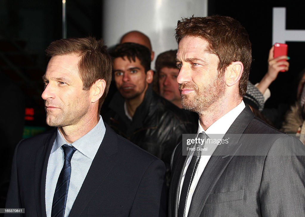 <a gi-track='captionPersonalityLinkClicked' href=/galleries/search?phrase=Aaron+Eckhart&family=editorial&specificpeople=220602 ng-click='$event.stopPropagation()'>Aaron Eckhart</a> and <a gi-track='captionPersonalityLinkClicked' href=/galleries/search?phrase=Gerard+Butler+-+Actor&family=editorial&specificpeople=202258 ng-click='$event.stopPropagation()'>Gerard Butler</a> attend the UK Premiere of 'Olympus Has Fallen' at BFI IMAX on April 3, 2013 in London, England.