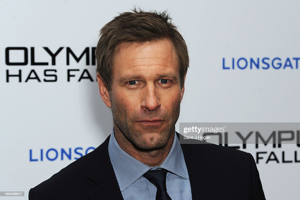 <a gi-track='captionPersonalityLinkClicked' href=/galleries/search?phrase=Aaron+Eckhart&family=editorial&specificpeople=220602 ng-click='$event.stopPropagation()'>Aaron Eckhart</a> attends the UK premiere of 'Olympus Has Fallen' at The IMAX on April 03, 2013 in London, England.