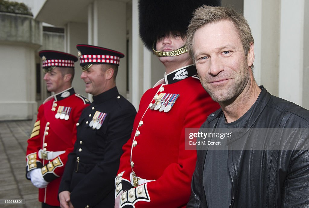 <a gi-track='captionPersonalityLinkClicked' href=/galleries/search?phrase=Aaron+Eckhart&family=editorial&specificpeople=220602 ng-click='$event.stopPropagation()'>Aaron Eckhart</a> poses with troops ahead of a special preview screening of Olympus Has Fallen, released in cinemas on April 17, at Wellington Barracks on April 4, 2013 in London, England.