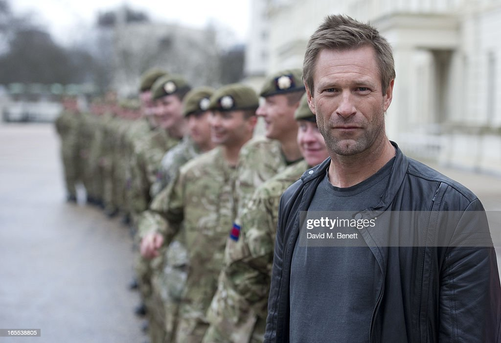 Aaron Eckhart poses with troops ahead of a special preview screening of Olympus Has Fallen, released in cinemas on April 17, at Wellington Barracks on April 4, 2013 in London, England.