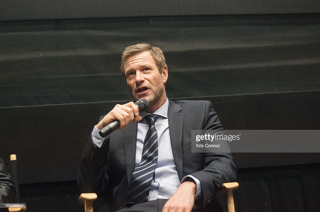 <a gi-track='captionPersonalityLinkClicked' href=/galleries/search?phrase=Aaron+Eckhart&family=editorial&specificpeople=220602 ng-click='$event.stopPropagation()'>Aaron Eckhart</a> speaks during the 'Olympus Has Fallen' screening at AMC Loews Georgetown 14 on March 12, 2013 in Washington, DC.