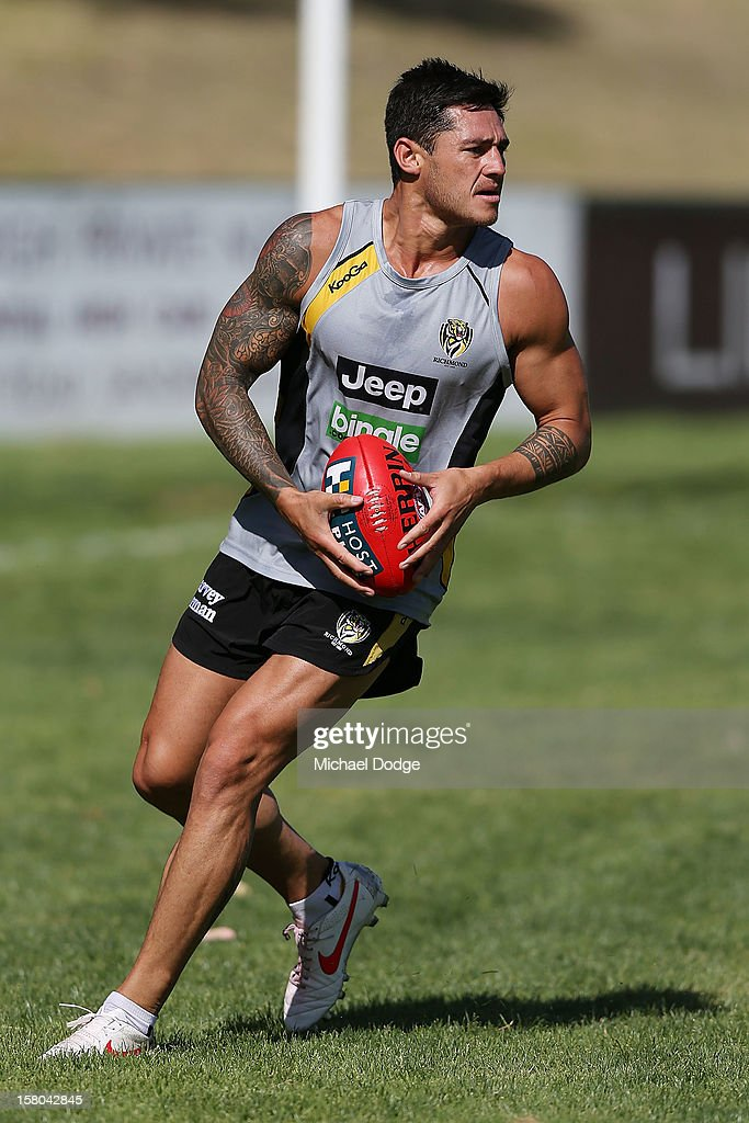Aaron Edwards looks on with the ball during a Richmond Tigers AFL training session at Trevor Barker Beach Oval on December 10, 2012 in Melbourne, Australia.