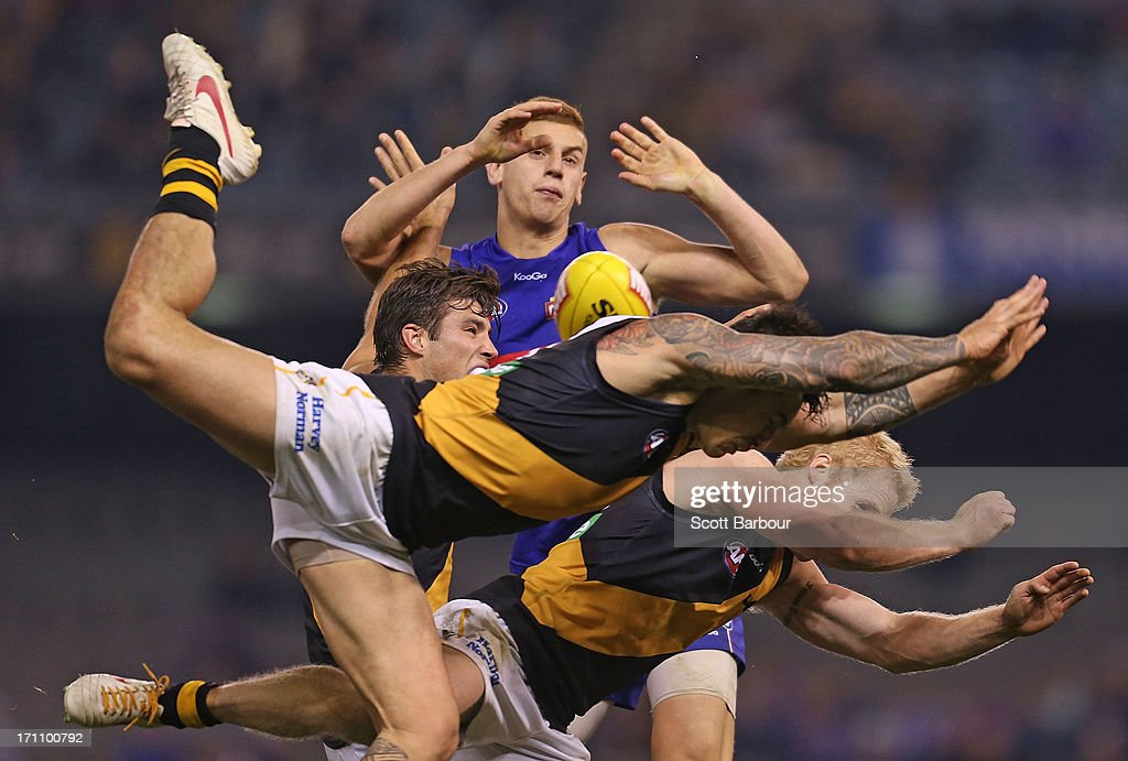 Aaron Edwards of the Tigers attempts to mark the ball during the round 13 AFL match between the Western Bulldogs and the Richmond Tigers at Etihad Stadium on June 22, 2013 in Melbourne, Australia.