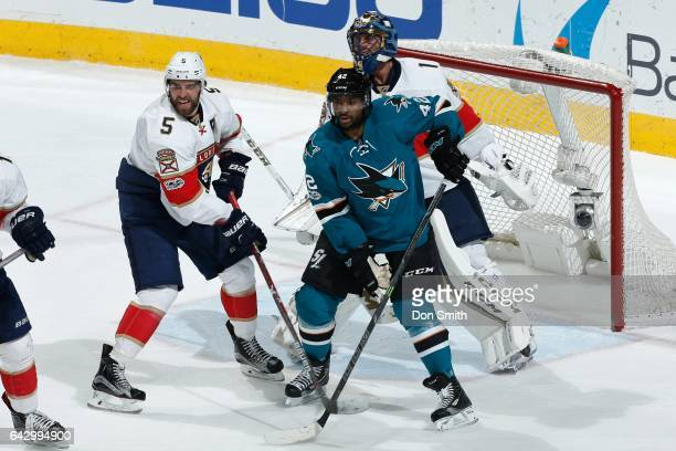 Aaron Ekblad and Roberto Luongo of the Florida Panthers defend against Joel Ward of the San Jose Sharks at SAP Center at San Jose on February 15 2017...