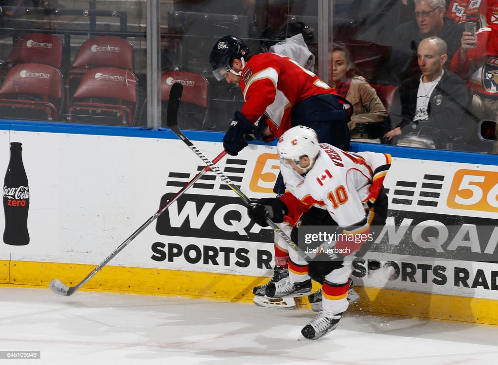 Aaron Ekblad #5 of the Florida Panthers battles along the boards with Kris Versteeg #10 of the Calgary Flames during third period action at the BB&T Center on February 24, 2017 in Sunrise, Florida. The Flames defeated the Panthers 4-2.