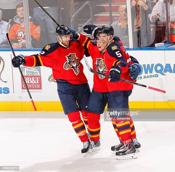 Aaron Ekblad of the Florida Panthers celebrates his goal with teammates Jussi Jokinen and Jimmy Hayes against the New York Islanders at the BBT...