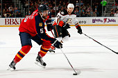Aaron Ekblad of the Florida Panthers skates with the puck against during the first period against the Anaheim Ducks at the BBT Center on November 19...