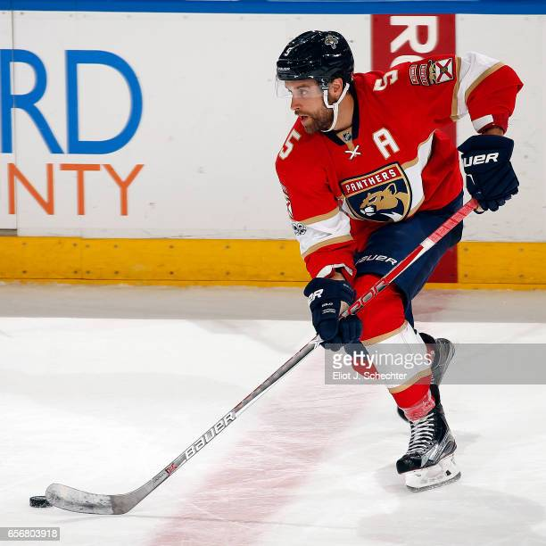 Aaron Ekblad of the Florida Panthers skates with the puck against the Carolina Hurricanes at the BBT Center on March 21 2017 in Sunrise Florida