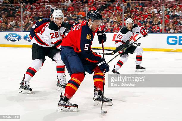 Aaron Ekblad of the Florida Panthers takes a shot against the New Jersey Devils at the BBT Center on April11 2015 in Sunrise Florida