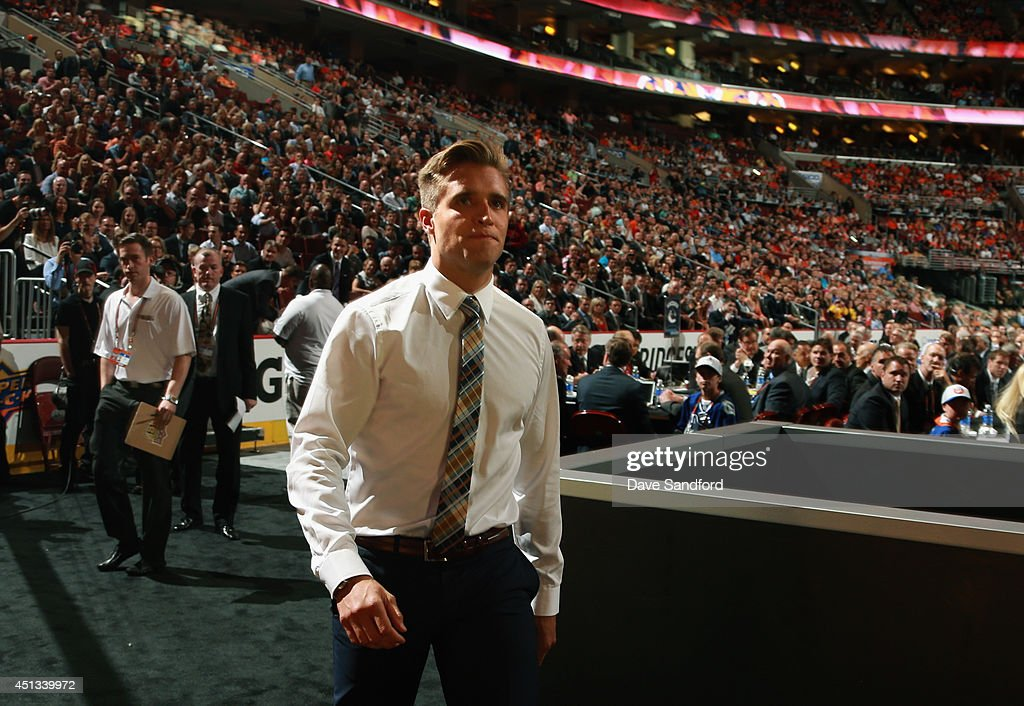 Aaron Ekblad walks to the stage after being selected first overall by the Florida Panthers during the 2014 NHL Entry Draft at Wells Fargo Center on June 27, 2014 in Philadelphia, Pennsylvania.