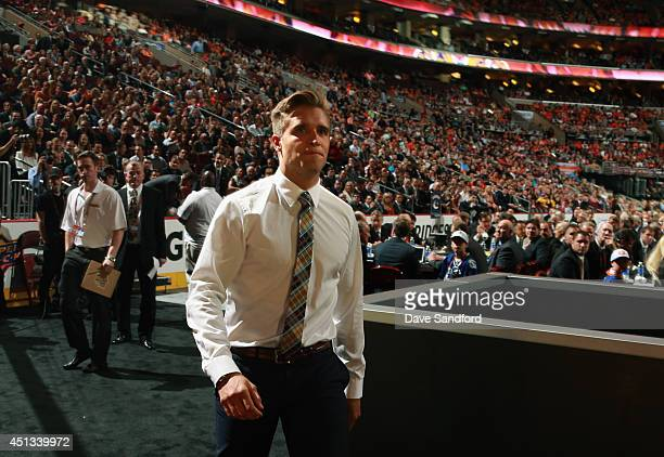 Aaron Ekblad walks to the stage after being selected first overall by the Florida Panthers during the 2014 NHL Entry Draft at Wells Fargo Center on...