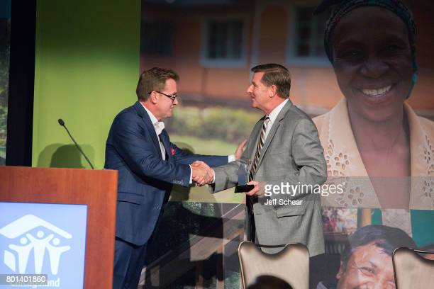 Aaron Erter President and General Manager of The Valspar Corporation presents the Habitat Hero Award to Whirlpool Corporation at the Habitat Hero...