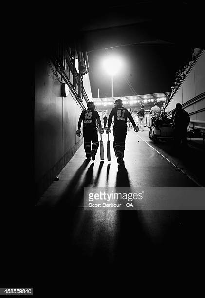 Aaron Finch and Ben Dunk of Australia walk out of the players tunnel to open the innings during game two of the International Twenty20 Series between...