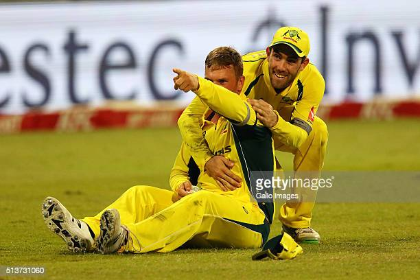 Aaron Finch and Glenn Maxwell celebrate the wicket of Chris Morris during the 1st KFC T20 International match between South Africa and Australia at...