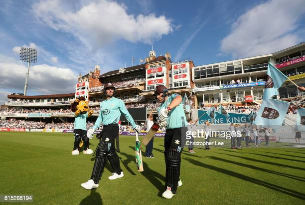 Aaron Finch and Jason Roy of Surrey walk out onto the pitch to bat during the NatWest T20 Blast match between Surrey and Kent at The Kia Oval on July...