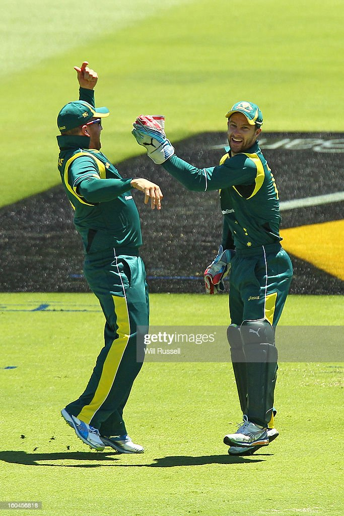 Aaron Finch and Matthew Wade celebrate after taking the wicket of Chris Gayle of the Windies during game one of the Commonwealth Bank One Day International Series between Australia and the West Indies at WACA on February 1, 2013 in Perth, Australia.