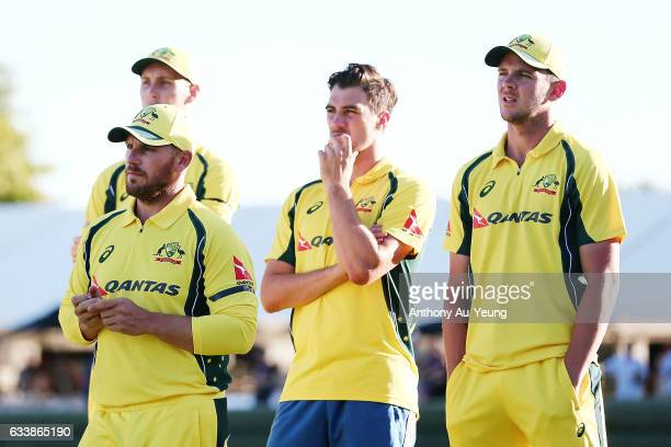Aaron Finch Billy Stanlake Shaun Marsh and Josh Hazlewood of Australia look on after losing game three of the One Day International series between...